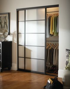 Door Do-Over. Classic sliding closet doors can be beautiful in this updated black frame finish with frosted panel front. Your reach-in closet never looked so stylish.
