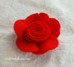 You could use these pretty felt flowers as hair clips, brooches, or even attach them to a wreath. I made mine with Valentine's Day in mind, but you can make them any size or color you need. The possibilities are endless!