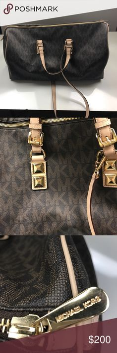 Authentic Micheal Kors Duffel Bag HUGE duffel bag. Barely used. Almost perfect condition.comes with shoulder strap. Last picture is compared to the regular MK duffle style purse. Michael Kors Bags Travel Bags