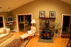 woodstove in upstairs living room Home Renovation, Home Remodeling, Family Room Addition, Rustic Basement, Basement Inspiration, Pole Barn Homes, Room Additions, Fireplace Surrounds, Cozy Living Rooms
