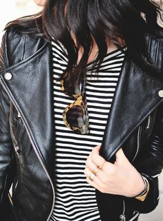 Style tip: hook your sunglasses from the neck of your t-shirt for a rocker-chic-inspired look.