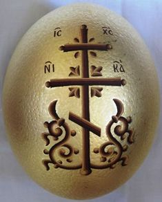 Hand painted ostrich egg with egg tempera colours and real gold sheets on background