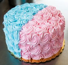 A pink and blue rosette cake that's prefect for a gender reveal party - or a baby shower for twins! Cake # 016
