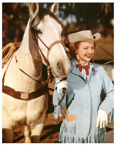 Dale Evans with her champion quarter horse Buttermilk, whose original name was Soda (and later Taffy). Buttermilk was found by trainer Glenn Randall, who turned this originally dangerous cow pony into a gentle steed for the Queen of the West. Being a quarter horse meant that Buttermilk could beat Roy Rogers' horse Trigger in short races. This wouldn't do for movies, so Dale (who had never ridden before working in westerns) had to learn to hold him back so Trigger would always lead.
