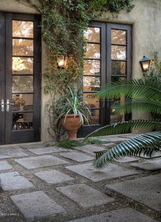 Black doors + patio stones + gravel- I will do this off the front of my bedroom someday...