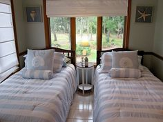 Twin beds in small guest bedroom - if having a couple for the night have a queen-maker kit, and use a square headboard on each bed then push beds together and throw decorative quilt over headboard to make single headboard