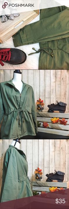 NWOT. Army Green Jacket 🎄Army green utility jacket 🎄2 flaps in front (not pockets) 🎄Zip up  🎄Tie at mid stomach, bottom front, and bottom back 🎄Slit in back   🐘BUST: 45in 🐘SHOULDERS: 20in 🐘SLEEVES: 31in 🐘LENGTH: 26 1/2in 🐘SHELL: 100% Cotton 🐘LINING: 100% Polyester  💋DISCLAIMER💋 - Reasonable offers accepted on items not marked 'price firm' - 15% off on bundles of 2 or more items - I do not discuss prices in the comments, but feel free to ask any other questions🙂 Jackets & Coats…