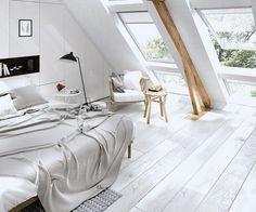 chambre adulte mansardée avec un grand lit et solive comme déco intérieur
