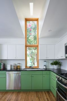 Tall kitchen window that punctures the eave line.
