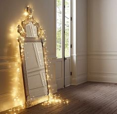 I love the ideas of putting twinkle lights around the mirror...looks magical. This would be Perfect in a little girls room!