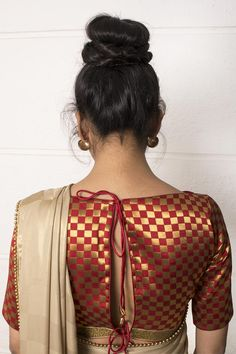 Check out this unusual brocade checked blouse in a subtly bold red and gold combination, complete with a classic boat neck silhouette and a double tie back. Make a fiery fashion statement by teaming with a black or gold saree. Whatsapp +91 81050 68601. *Shipping worldwide* #saree #blouse #sareeblouse #blousedesigns #desi #indianfashion #india #bollywood #red #gold #brocade
