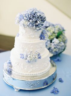 Such beautiful piping. Lovely white wedding cake set atop a silver cake stand and decorated with powder blue Hydrangea. Floral Wedding Cakes, Wedding Cakes With Cupcakes, White Wedding Cakes, Elegant Wedding Cakes, Wedding Cake Designs, Wedding Cake Toppers, Rustic Wedding, Elegant Cakes, Floral Cake