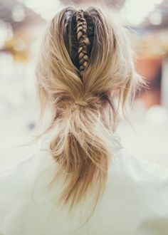 A low bun with a skinny braid down the center. So cute.