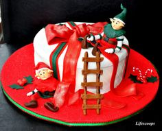 X'mas Cake - Santa's Elves at Work (Spiced Apricot and Raisin cake with Pineapple and Whipped cream filling, frosted in Vanilla Butter cream)
