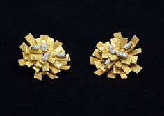 18k Gold and diamond earrings by the renowned English designer Andrew Grima, c 1960's.