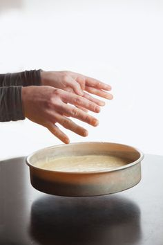 """Cake Tip: Settle the batter by dropping the pan on the counter from a foot up. (""""Only do this for cakes leavened with baking soda or baking powder, however; egg foam cakes, like genoise, need their air bubbles in order to rise."""")"""