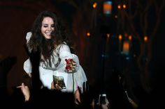 Lana Del Rey grabs a rose from a fan as she performs in concert at Bill Graham Civic Auditorium in San Francisco http://www.mercurynews.com/music/ci_25599190/review-lana-del-rey-dazzles-san-francisco