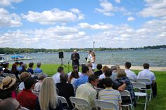 Ceremony, couple facing the crowd, officiant to the side a bit