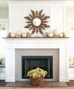Simple & sweet mantle decor. white fireplace penny tile