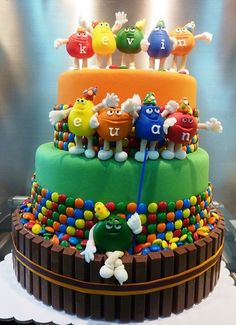 M & M Cake. Melts in your mouth, not in your hands! Lovvve me some M & M's. Plain of course.
