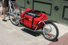 this bike trailer convers into a wheel barrel like cart // great concept for the… Bike Cargo Trailer, Cargo Bike, Bike Trailers, Pull Behind Motorcycle Trailer, Bobs, Bike Cart, Folding Bicycle, Bicycle Accessories, Bike Design