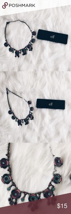 """F21 Dark Gem Toned Statement Necklace ▪️Product Description▪️ ▫️Dark and cool statement piece with gorgeous purple, turquoise, and bright blue designs  ▫️Backside is plain black  ▫️Heavy piece  ▪️Condition: NWOT ▪️Measurements: ▫️20"""" Forever 21 Jewelry Necklaces"""