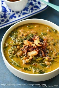 Garlicky, spicy and creamy curry with Spinach, Black Eyed Peas Curry and Coconut. It is so good and comforting that you can just slurp spoonsful of it Pea Recipes, Curry Recipes, Indian Food Recipes, Asian Recipes, Soup Recipes, Vegetarian Recipes, Cooking Recipes, Healthy Recipes, Ethnic Recipes