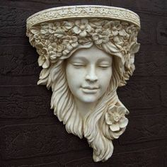 Art Nouveau Corbel In architecture a corbel is a stone or wood projection jutting out from a wall to support a weight. In houses and other structures corbel Abstract Sculpture, Sculpture Art, Garden Sculptures, Metal Sculptures, Bronze Sculpture, Garden Wall Planter, Wall Planters, Shading Techniques, Carnival Masks