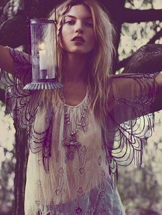 This is a great pic. She's very conservatively relieved and elegant with her hippie bohemian top. Her lace shall almost looks like spider webs which is a very earthy, classic hippie look.
