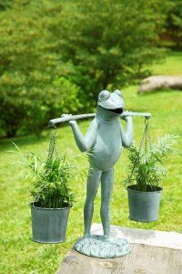 Add whimsy to your garden with frog statues...  http://www.squidoo.com/frog-statues Frog Garden Statues