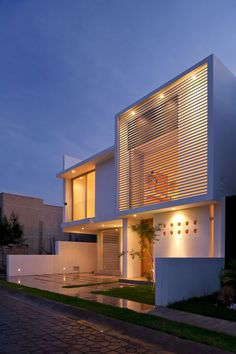 """Seth Navarrete House is located in Zapopan, in the state of Jalisco, Mexico, and was designed by Agraz Arquitectos. The home is designed with straight lines and in colors of white and beige, with an emphasis on Minimalism.                     Seth Navarrete House by Agraz Arquitectos: """"A young couple with a keen and clear mind asked for an architectural design that would bring out the most of the spatial quality for their life scenery on a 200 square meter (2150 ft2) terrain with a short…"""