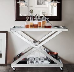 restoration hardware bar cart, crystal decanters.