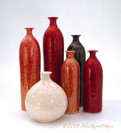 These beautiful wheel thrown bottle forms feature Marietta's unique metallic finish, or otherwise lustres, that gives them their unique reflective surfaces. All bottles are MADE TO order and will be s