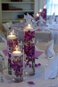 Orchids with floating candle by Floral Whimsy