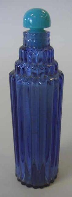 René Lalique Perfume Bottle '' Je Reviens '' Blue glass skyscraper motif body with turqoise glass dome stopper 14 centimeters Model: Worth-Perfume Circa 1928