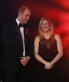 The Duke of Cambridge with Ellie Goulding at a fundraising event and awards evening in aid of Centrepoint, a charity which supports young rough sleepers, at Kensington Palace in London