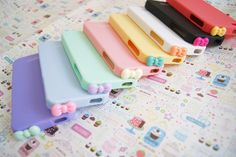 YOU CHOOSE Sherbert Pastel Silicone Cell IPhone 4 4s Case with Bowtie Dust Stopper. $15.50, via Etsy.