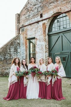Winter bridal party, red bridesmaid dresses, cream colored shawls, follow this board for more wintertime wedding inspiration // Anna Benton Photography