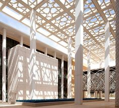 Decorative screens and mashrabiya adorn the façades of these contemporary structures, incorporating historical language into modern settings.