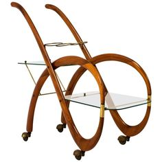 Breathtaking Italian Mid-Century Modern Bar Cart by Gaetano Pizzi, 1950s | From a unique collection of antique and modern carts and bar carts at https://www.1stdibs.com/furniture/tables/bar-carts/