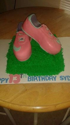 Soccer shoes and grass cake