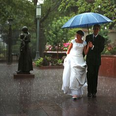 get a picture of us under an umbrella in the rain- or have someone create the rain for us!