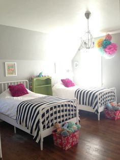 White bed, gray walls.. Easy for adding any other colors