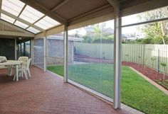 Slide Track Blinds are fully enclosed, with the fabric locking into a side channel to secure it. Bozzy Shade Blinds Perth Australia