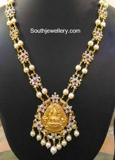 22 Carat gold antique floral haram with Lakshmi pendant adorned with cz stones, rubies and pearls. Pearl Necklace Designs, Jewelry Design Earrings, Mom Jewelry, Jewelry Model, Gold Jewellery Design, Bridal Jewelry, Beaded Jewelry, Ruby Necklace, Coral Jewelry
