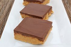 """Homemade """"reeses"""" peanut butter bars  1 cup butter, unsalted and melted  2 cups graham cracker crumbs  2 cups powdered sugar  1-1/4 cup peanut butter, divided  1-1/2 cups milk chocolate chips"""