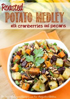 Roasted Potato Medley | http://DizzyBusyandHungry.com - Sweet potatoes, white potatoes, red potatoes, and red onions roasted in garlic with olive oil and tossed with dried cranberries and pecans.