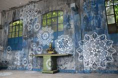 Just because street art is a relatively modern development doesn't mean that it should only feature modern artistic styles. NeSpoon, a street artist in Poland, creates beautiful pieces of street art that imitate intricate traditional lacework.