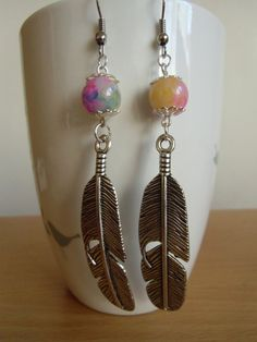 Silver feather with colorful beads cute dangle earrings.