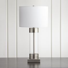Sale ends soon. Shop Avenue Nickel Table Lamp with USB Port. An illuminating mix of modern and metal, our grandly scaled table lamp caps off its clear glass base with silvery nickel accents and a crisp white drum shade. Crate And Barrel, Usb Lamp, Brass Table Lamps, Round Wall Mirror, Hacks, Incandescent Bulbs, Drum Shade, Glass Table, Home Lighting